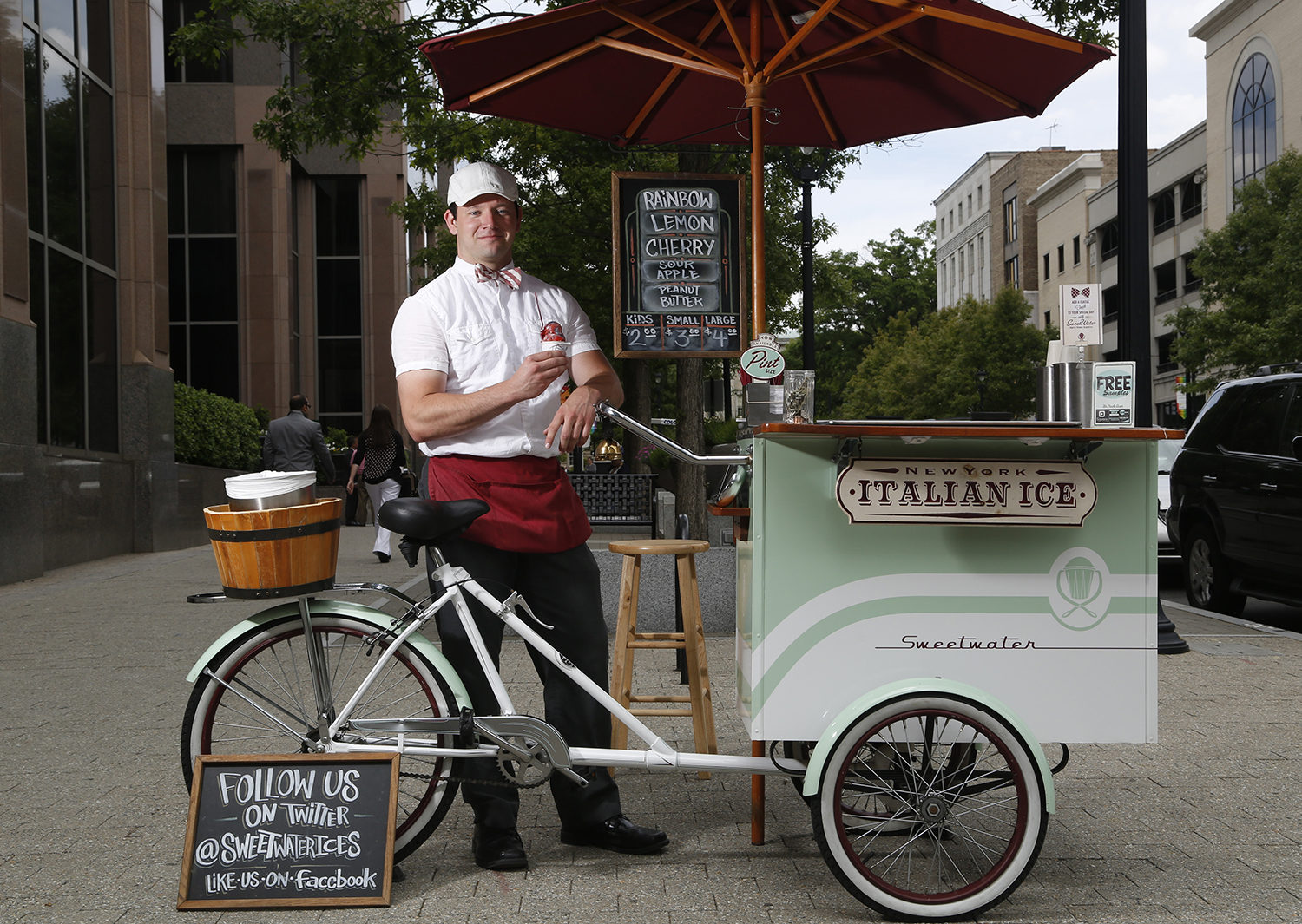 Michael Beggen, co-owner of SweetWater Ices, serves up cold treats on Fayetteville Street in downtown Raleigh.